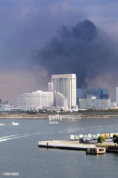 Smoke rises from a construction site following an earthquake on March 11 2011 in Tokyo Japan A magnitude 88 strong earthquake hit the northeast coast...