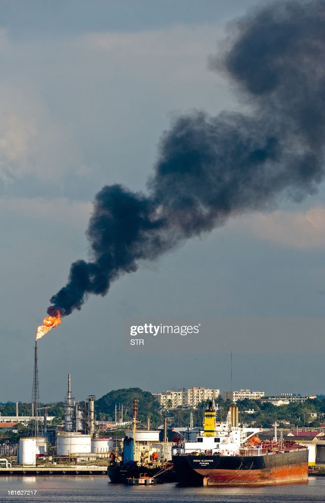 Smoke rises from a factory chimney in Havana on February 13, 2013. AFP PHOTO/STR