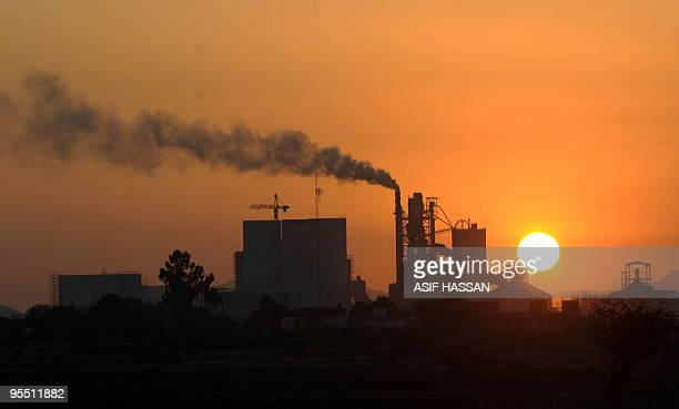 Smoke rises from a factory during the year's last sunset in Karachi on December 31 2009 The United Nations is relocating a limited number of its...