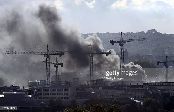 Smoke rises from a fire at the 360million GBP SouthGate shopping centre currently under development on September 23 2008 in Bath England Police said...