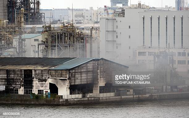 Smoke rises from a steel plant beside a river in Kawasaki near Tokyo's Haneda airport on August 24 2015 A huge blaze broke out August 24 in a steel...