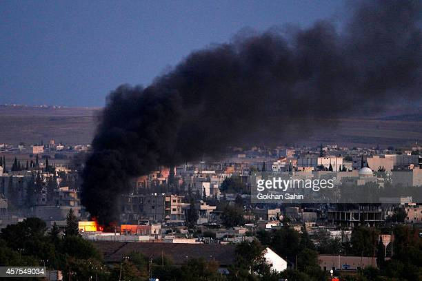 Smoke rises from an explosion that ocked Syrian city of Kobani during a reported suicide car bomb attack by the militants of Islamic State group on a...