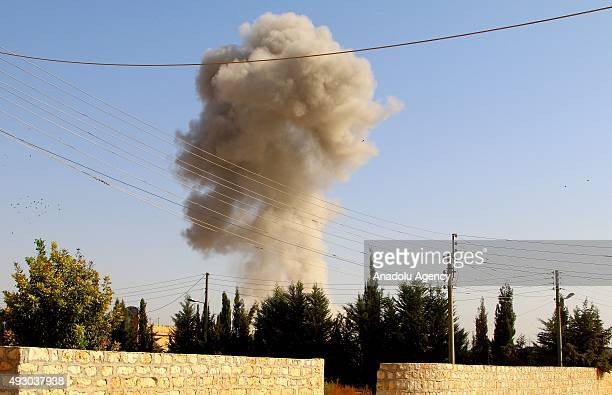 Smoke rises from an oppositioncontrolled residential area in Aleppo Syria following the Russian airstrikes on October 17 2015