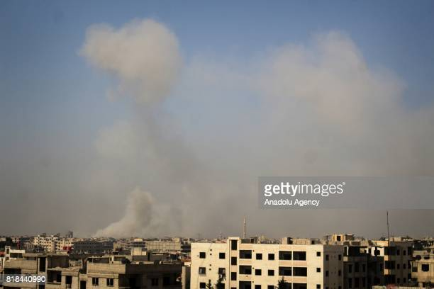 Smoke rises from buildings after Assad Regime's forces hit deconflict zone of opposition controlled Ein Terma region in Damascus Syria on July 18 2017