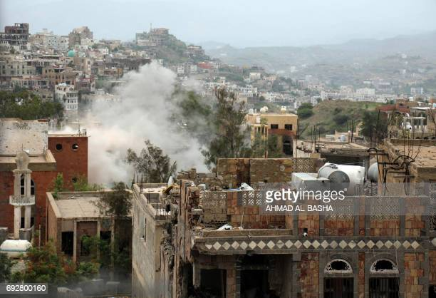 Smoke rises from buildings in the country's thirdcity of Taez during clashes between Yemeni tribesman from the Popular Resistance Committee...
