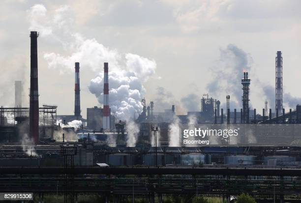 Smoke rises from chimneys at the Cherepovets Steel Mill operated by Severstal PJSC stands in Cherepovets Russia on Wednesday Aug 9 2017 Global...