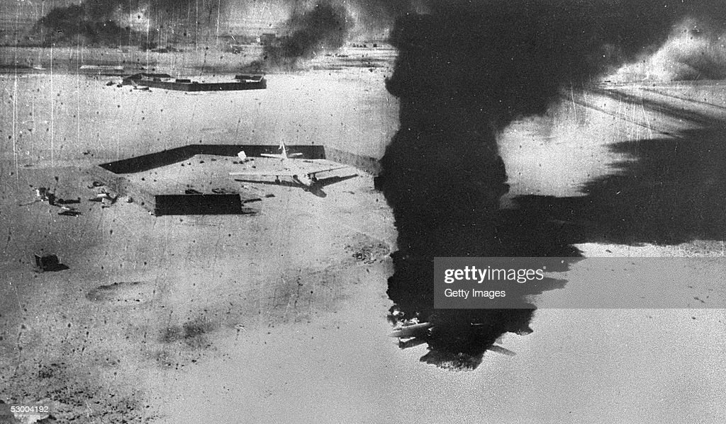 Smoke rises from destroyed Egyptian airplanes during an Israeli Air Force preemptive strike June 5 1967 against Egyptian airfields at the start of...