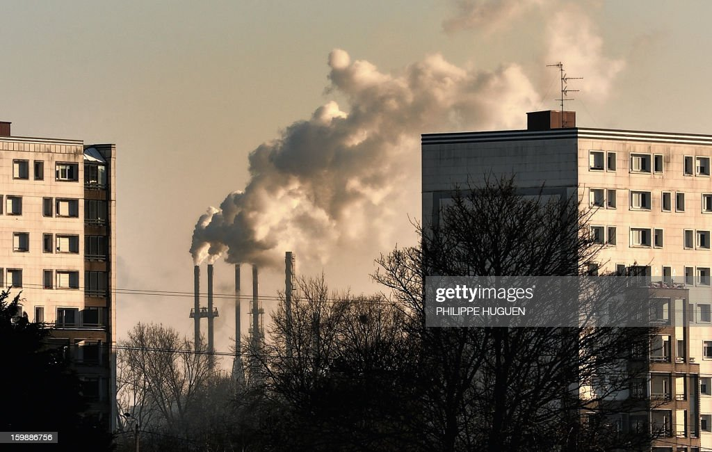 Smoke rises from factory stacks in Santes, near Lille, on January 22, 2013. AFP PHOTO / PHILIPPE HUGUEN