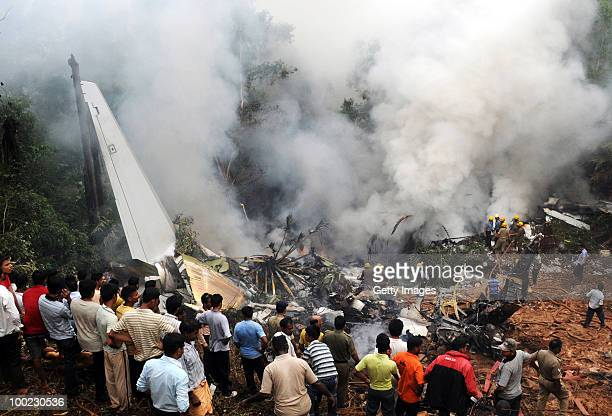 Smoke rises from the air plane crash site on May 22 2010 in Mangalore An Air India Express Boeing 737800 series aircraft overshot the runway on...
