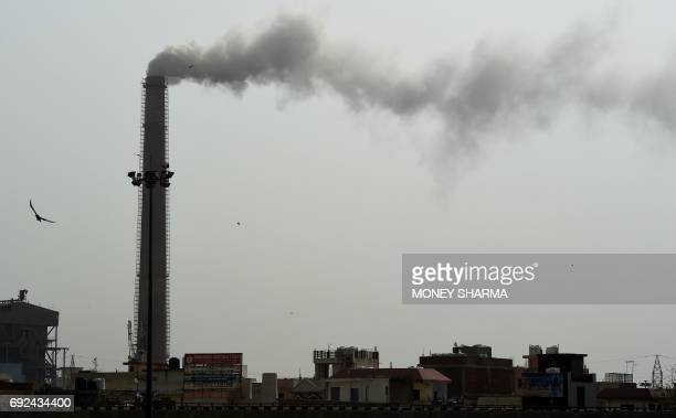 Smoke rises from the Badarpur Thermal Power Station in New Delhi on June 5 on the United Nation's World Environment Day India is the world's third...