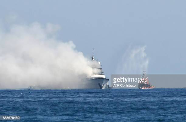 Smoke rises from the boat 'If Only' a 39meterlong yacht that is on fire off SaintLaurentduVar near Nice southern France on August 17 2017 The yacht...