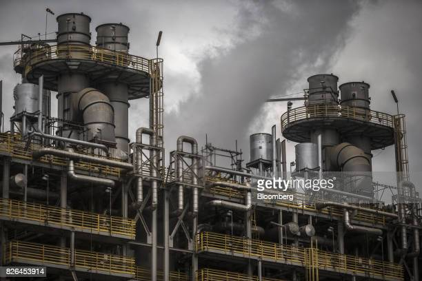 Smoke rises from the Braskem SA petrochemical plant in Duque de Caxias Brazil on Friday Aug 4 2017 Petroleo Brasileiro SA and Odebrecht SA proposed...