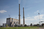 Smoke rises from the chimney at NRG Energy's Joliet Station power plant on May 7 2015 in Joliet Illinois According to scientists global carbon...