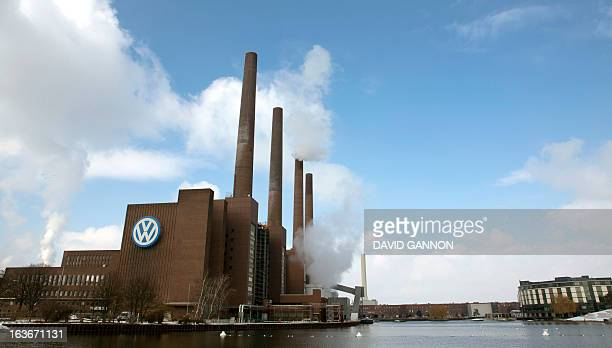 Smoke rises from the chimneys at German car maker Volkswagen's plant on March 14 2013 in Wolfsburg northern Germany AFP PHOTO / DAVID GANNON