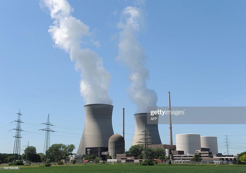 Smoke rises from the cooling towers the