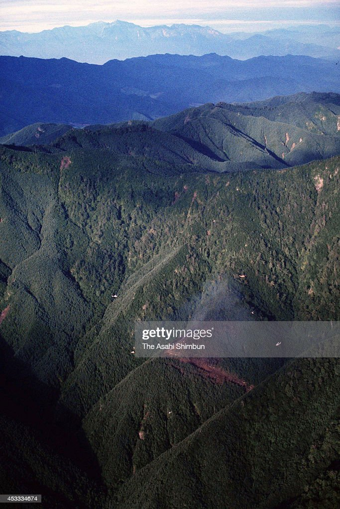 Smoke rises from the crash site at the ridge of Mount Osutaka a day after the air crash on August 13 1985 in Ueno Gunma Japan Japan Airlines flight...