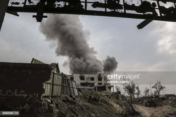 Smoke rises from the debris of a building as clashes between opposition forces and Assad regime forces continue in Jobar district of Damascus Syria...