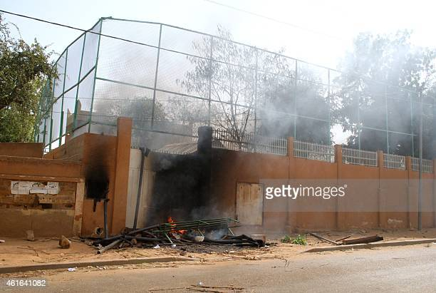 Smoke rises from the FrancoNigerien Cultural Center in Zinder after it was burned down during demonstrations after Friday prayer on January 16 2015...