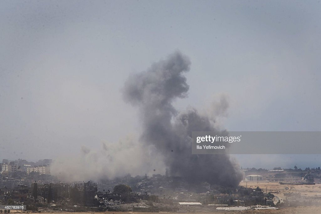 Smoke rises from the Gaza Strip after Israeli shelling moment before the 24 hour ceasefireon July 27, 2014 on the Israeli/Gaza border, Israel. Forty-two Israeli soldiers and over 1,000 Palestinians have been killed as the Israeli operation 'Protective Edge' nears three weeks.