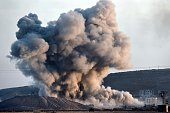Smoke rises from the impact of an airstrike next to the hill where Islamic State militants had placed their flag in the Syrian town of Ain alArab...
