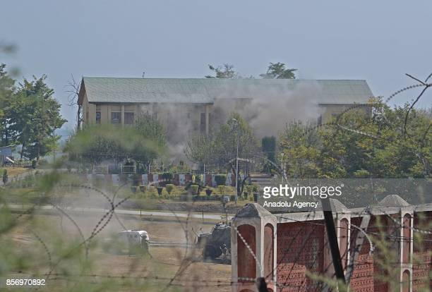 Smoke rises from the Indian military building after it was blasted by Indian army where last suspected militant was believed to be holed up in...