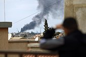 Smoke rises from the port of the eastern Libyan city of Benghazi on February 14 2015 during clashes between forces loyal to the internationally...