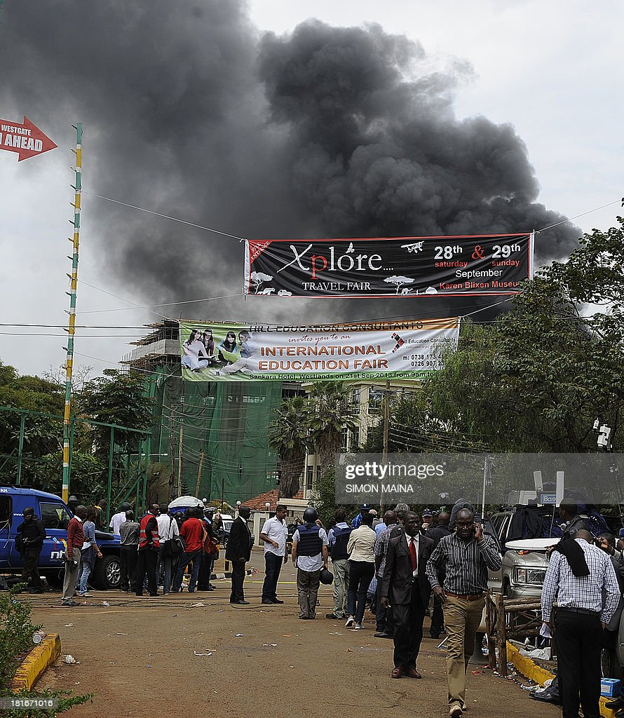 Smoke rises from the roof top of the Westgate mall on September 23 2013 in Nairobi as Kenyan troops are locked in a fierce firefight with Shebab...