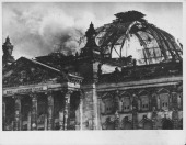 The burnt shell of the Reichstag building on fire though the main dome remains intact prior to World War Two 1933