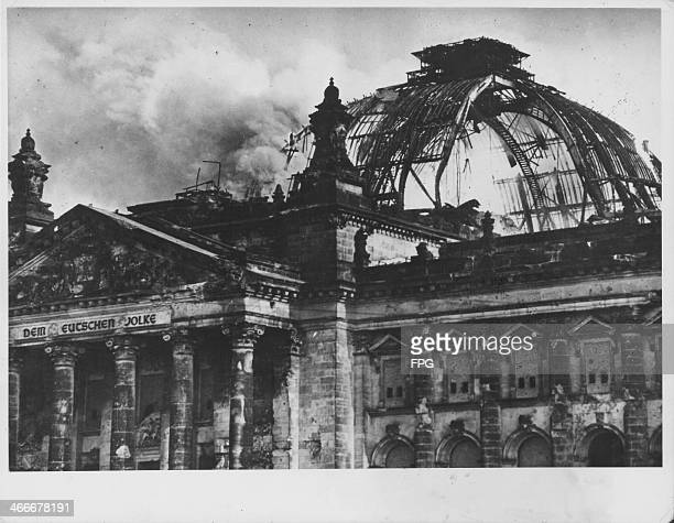 Smoke rises from the ruins of the Reichstag building Berlin World War Two circa 1945