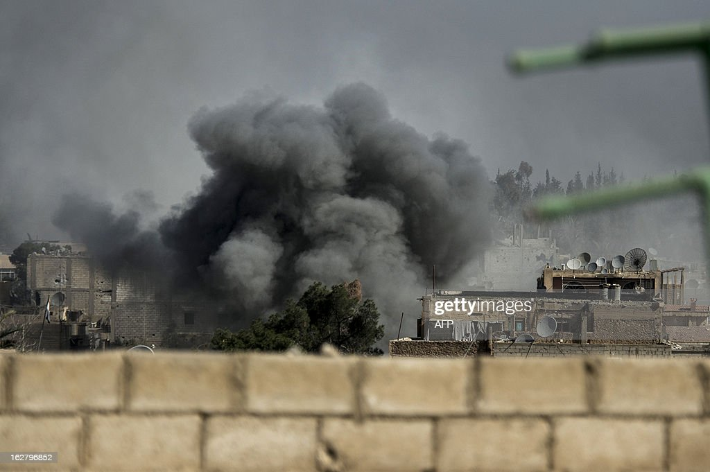 Smoke rises from the site of a missile attack in Hawiqah neighbourhood in the eastern Syrian town of Deir Ezzor on February 26, 2013. An AFP correspondent in Deir Ezzor said on February 26, that two MiGs flew repeated low-level sorties over the Sheikh Yassin neighbourhood for more than three hours during the morning, droping at least 50 bombs on rebel positions.