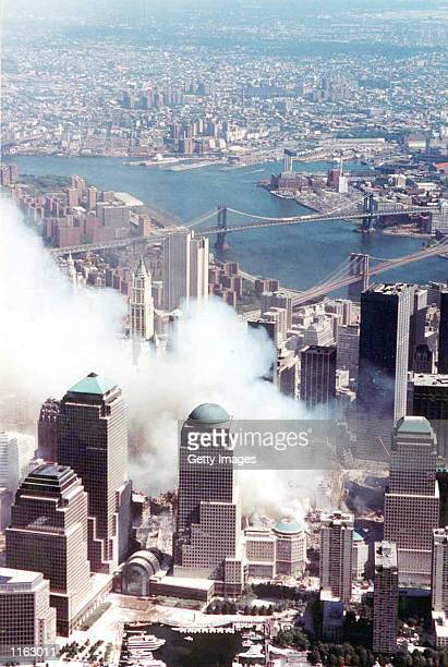 Smoke rises from the site of the World Trade Center terrorist attack September 14 2001 in New York City