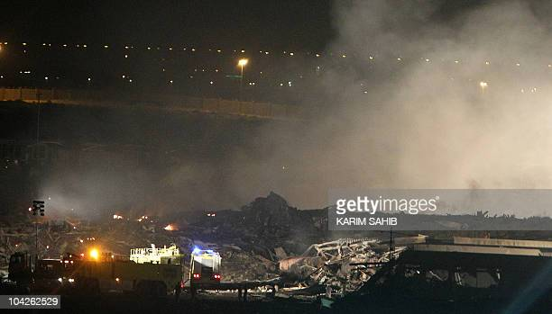 Smoke rises from the the crash scene of a cargo plane owned by US courier United Parcel Service at a military base in Dubai late on September 3 2010...