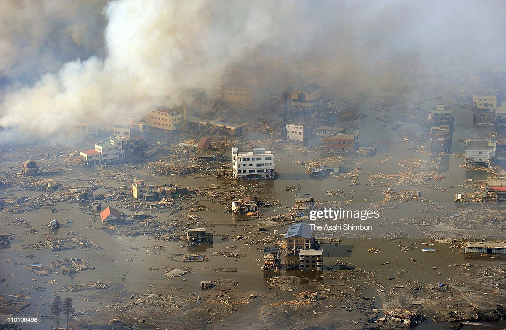 Smoke rises from tsunami ruined Otsuchi Town after a 90 magnitude strong earthquake struck on March 11 off the coast of northeastern Japan on March...