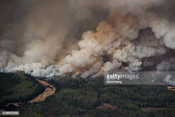Smoke rises from wildfires burning in this aerial photograph taken above Fort McMurray Alberta Canada on Friday May 6 2016 The wildfires ravaging...