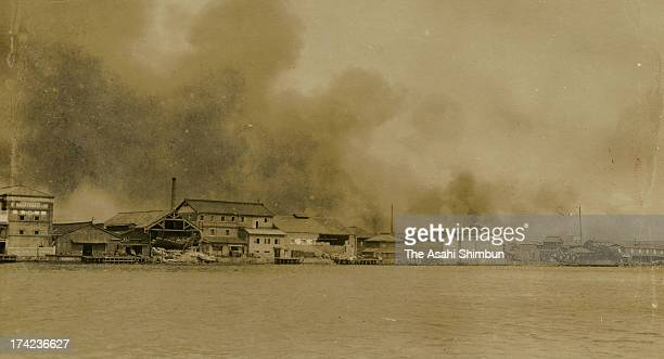 Smoke rises from Yokohama city after the Great Kanto Earthquake in September 1923 in Yokohama Kanagawa Japan The estimated Magnitude 79 strong...
