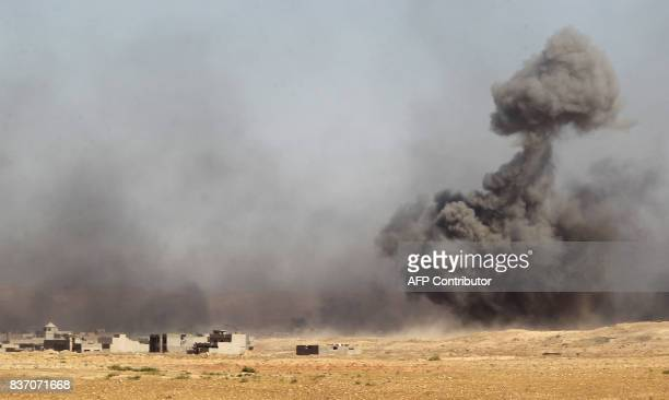 Smoke rises in the background as Iraqi forces backed by the Hashed AlShaabi advance towards the town of Tal Afar west of Mosul after the Iraqi...