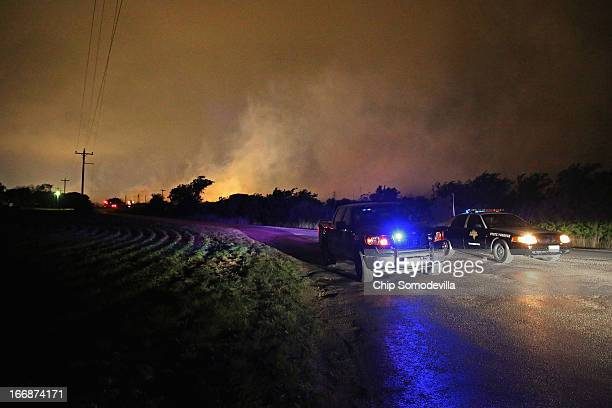 Smoke rises in the distance about half a mile from the West Fertilizer Company April 18 2013 in West Texas A massive explosion at the fertilizer...
