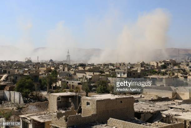 Smoke rises into the air after Assad Regime's forces air strikes over the residential areas in the deconflict zone Jobar district in the Eastern...