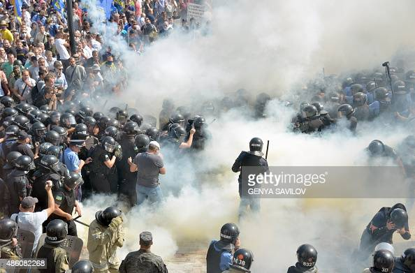 Smoke rises near the parliament building in Kiev as activists of radical Ukrainian parties including the Ukrainian nationalist party Svoboda clash...