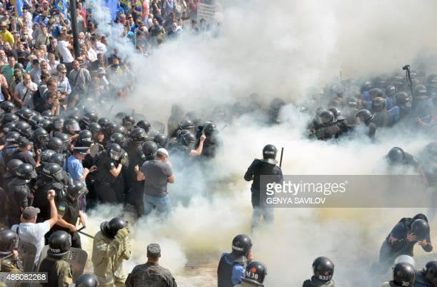 Smoke rises near the parliament building in Kiev as activists of radical Ukrainian parties including the Ukrainian nationalist party Svoboda clash...
