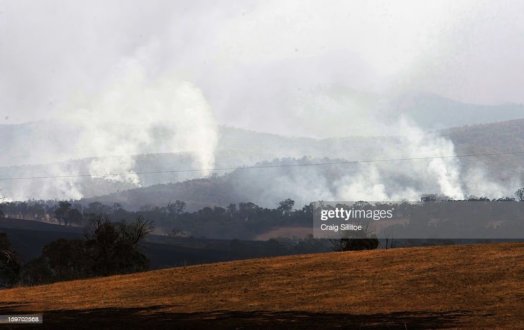 Smoke rises near the town of Seaton on January 19, 2013 in Melbourne, Australia. Bushfires in Victoria have claimed one life and destroyed several houses. Record heat continues to create extreme fire conditions throughout Australia.