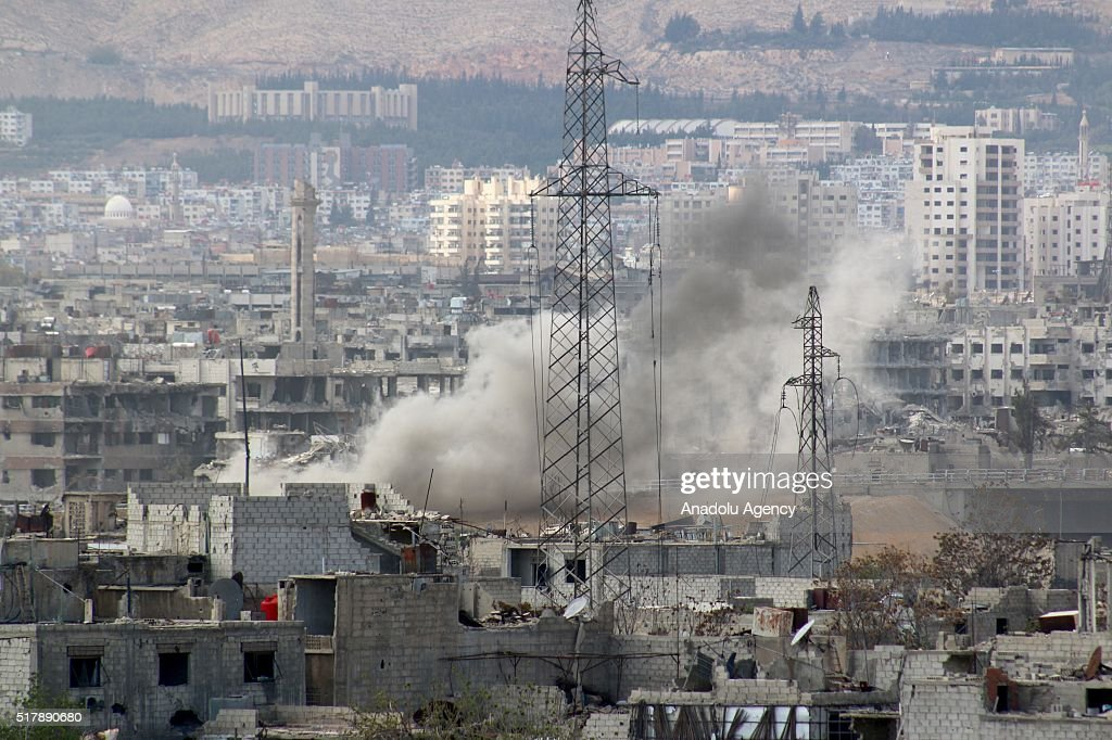 Smoke rises over the buildings after the Assad regime forces attacked on opposition controlled Cobar area of Eastern Ghouta region in Damascus Syria...
