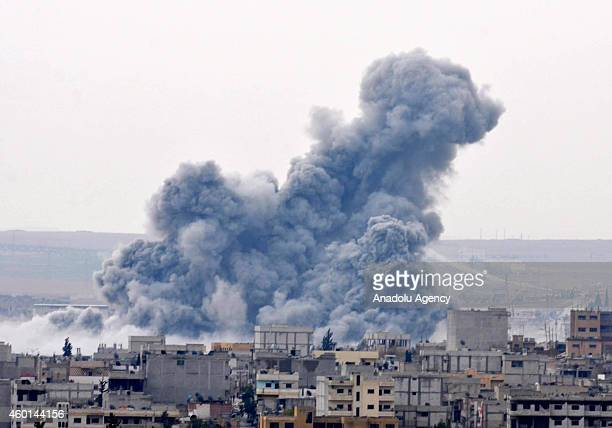 Smoke rising during the clashes between Islamic State of Iraq and Levant members and armed groups in Kobani is seen from Turkey's Suruc district of...
