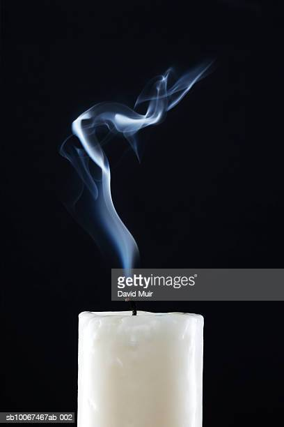 Smoke rising from extinguished candle, close-up