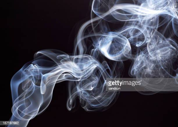 Smoke rising with black background