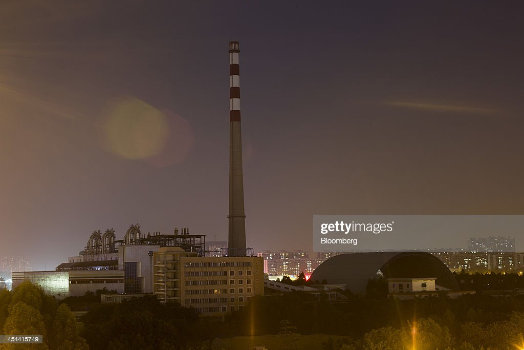 A smoke stack stands at a factory in the Pazhou district of Guangzhou, Guangdong province, China, on Tuesday, Nov. 26, 2013. China is proposing the largest package of economic reforms since the 1990s to stoke growth in the worlds biggest emerging market. Photographer: Brent Lewin/Bloomberg via Getty Images