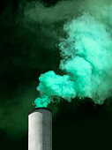 Smoke stack with green smoke billowing out