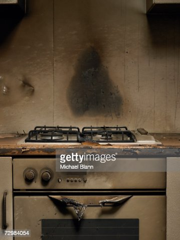 Smoke stained cooker in kitchen after fire : Stock Photo