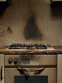 Smoke stained cooker in kitchen after fire