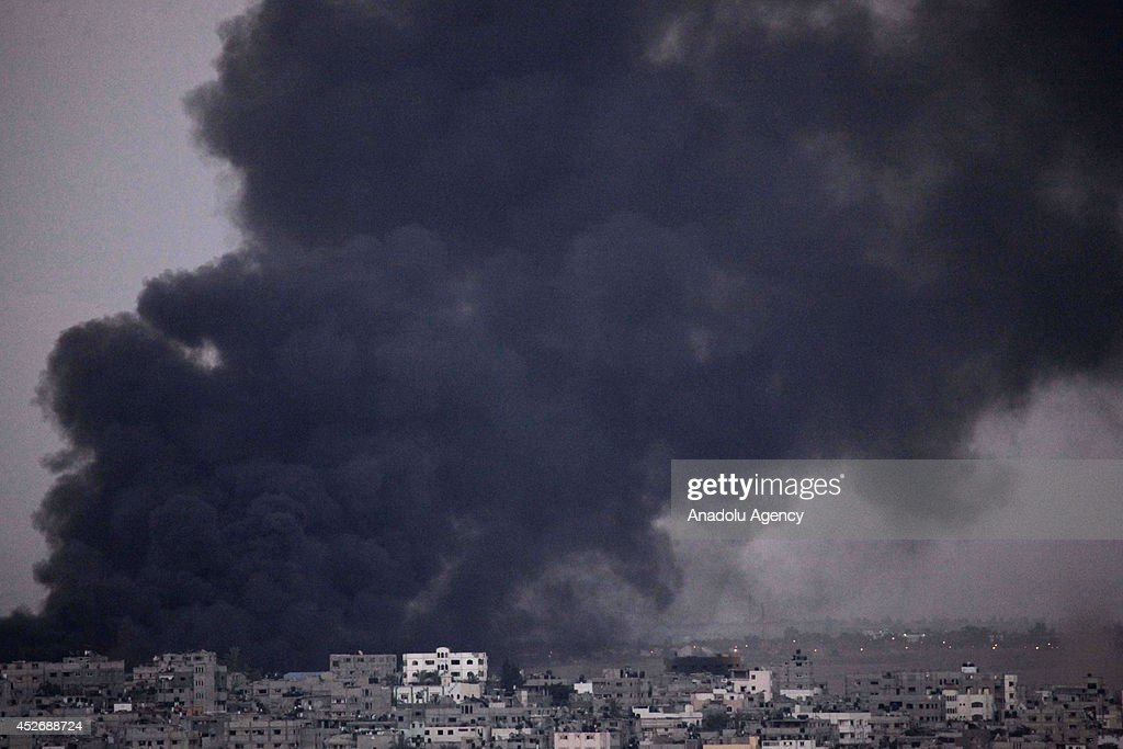 Smoke trails over Gaza city after Israeli shelling on July 25,2014. The new fatalities raise Gaza's death toll from Israel's war to 884 since the beginning of this war on July 7, Health Ministry spokesman Ashraf al-Qodra said. Since July 7, Israel has pounded the Gaza Strip with fierce aerial bombardments with the ostensible aim of halting rocket fire.